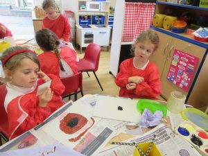 Schoolgirls are painting different objects